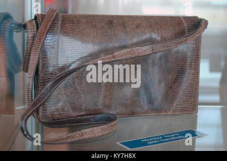 handbag made of monitor lizard skin for black market trade - Stock Image