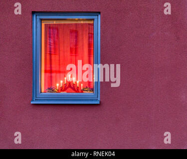 Exterior view of window lit up by Christmas Advent bridge lights - Stock Image