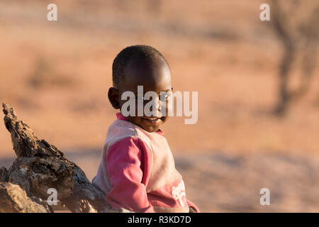 Africa, Namibia, Damaraland. Portrait of young boy. Credit as: Wendy Kaveney / Jaynes Gallery / DanitaDelimont.com - Stock Image