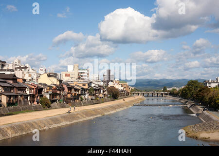 Riverbed with homes on the banks in Japan - Stock Image