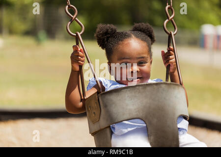 Happy African American little girl smiling. - Stock Image
