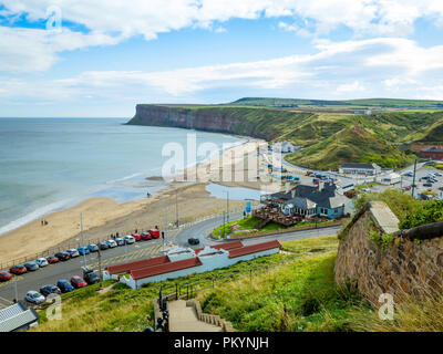 Saltburn by the Sea view from the cliff above the pier southwards to Warsett Hill and imposing Huntcliff - Stock Image