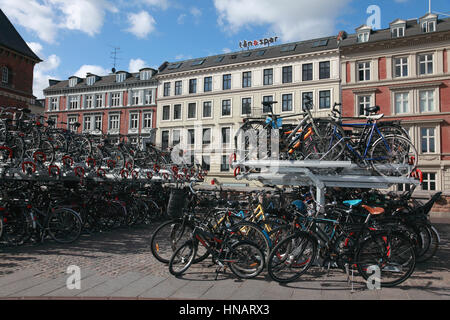 Bicycles parked outside Copenhagen Central Station, Denmark - Stock Image