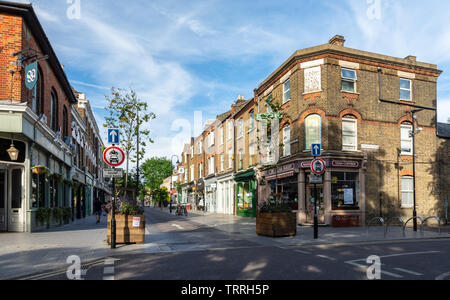 London, England, UK - June 1, 2019: Pedestrians browse shops on Orford Road in The Village neighbourhood of Walthamstow in East London. - Stock Image