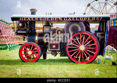 A Burrell showman's steam traction engine 'His Majesty' working at an English show - Stock Image