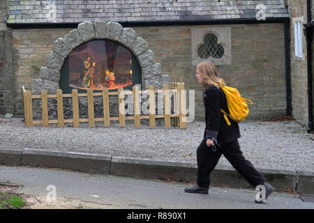 People walking past a crib, nativity scene, in Falmouth, Cornwall, - Stock Image