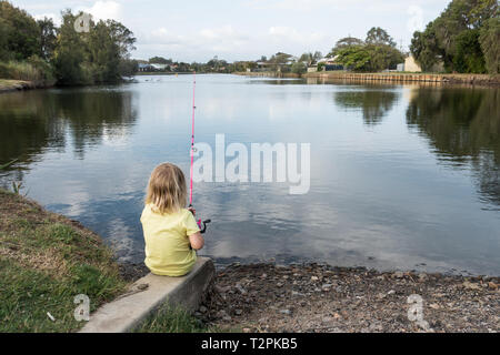 Four year old girl fishing at a local pond. Beachmere Queensland Australia. - Stock Image