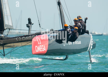 Portsmouth, UK. 25th July 2015. Emirates Team New Zealand cross the line to win the second race of the series closely - Stock Image