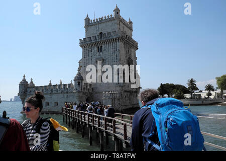 UNESCO World Heritage Site Belem Tower people tourists queue to go inside the historic 16th Century building Lisbon Portugal Europe EU  KATHY DEWITT - Stock Image