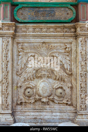 White marble carved wall of an ablution fountain at the courtyard of the great Mosque of Muhammad Ali Pasha, Citadel of Cairo, Egypt - Stock Image