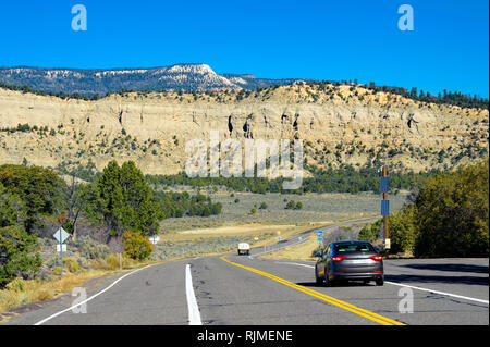 Vehicles traveling on Route 12 between Henrieville and Escalante, Utah, USA - Stock Image