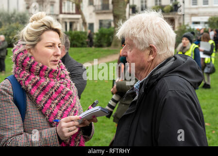 London, UK. 26th January 2019. London protest against the intended resumption of whaling by Japan.The Japanese government recently backed out of an international agreement banning commercial whaling. Campaigners rally at Cavendish Square for the march to the Japanese Embassy. Pictured being interviewed in Cavendish Square, Boris Johnson's father, Stanley Johnson.  Credit: Stephen Bell/Alamy Live News. - Stock Image
