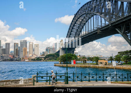 Sydney harbour bridge and view across the harbour to the skyscrapers and cityscape of Sydney city centre,New South Wales,Australia - Stock Image