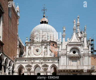 Clock of Basilica di San Marco St Marks Basilica Cathedral from the courtyard of the Palazzo Ducale or Doges Palace - Stock Image