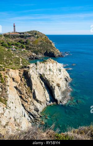 France, Pyrenees Orientales, Cote Vermeille, hiking from Port-Vendres to Banyuls on the coastal path, Cap Bear lighthouse in the background - Stock Image