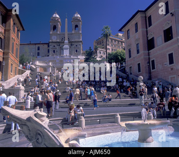Spanish Stairs leading up to church of Trinità dei Monti and in front fontain at Piazza di Spagna downtown - Stock Image