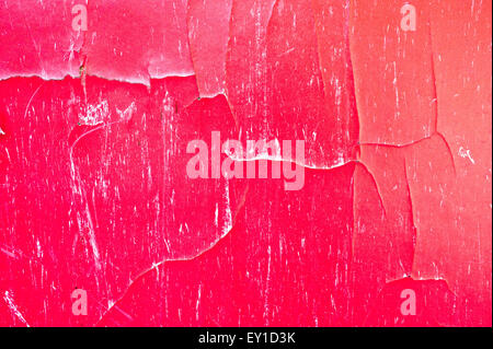 A cracked red wooden surface as a background - Stock Image