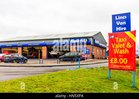 kwik fit tyre tire replacement service centre center new tyres exhausts valet and wash sign - Stock Image