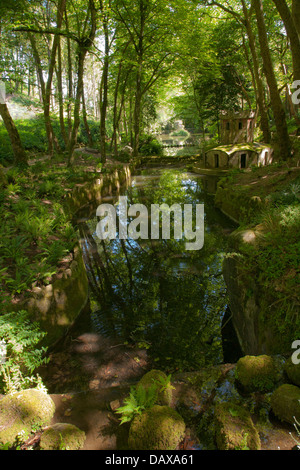 Pena Palace Gardens, Duck house and stream in a woodland arcade, Sintra, Portugal - Stock Image