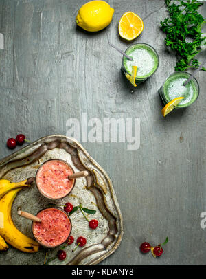 Healthy smoothies of fruits and herbs. On a wooden table. - Stock Image