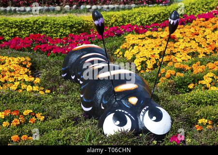 Statue of Big Centipede Caterpillar in Beautiful Flower Gardens in a small City of Boquete, Panama Highlands - Stock Image
