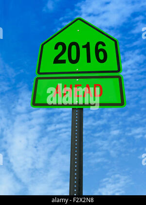 2016 ahead road sign over blue sky with clouds - Stock Image