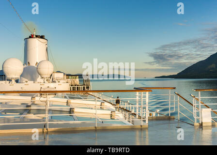 September 17, 2018 - Clarence Strait, AK: Early morning view at sunrise from damp outdoor top deck of The Volendam cruise ship, near Ketchikan. - Stock Image