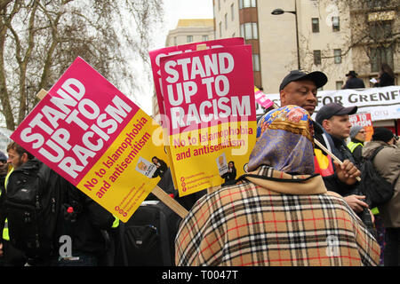 London, UK - 16 March 2019: A uslim woman hold up placards ahead of the march fromPark Lane. Thousands of people took part in the UN Anti-Racism Day demonstration that took place in central London on 16 March. The demonstration which began in Park Lank and ended outside Downing Street was organised by Stand Up to Racism and Love Music Hate Racism and supported by the TUC and UNISON. Photo: David Mbiyu Credit: david mbiyu/Alamy Live News - Stock Image