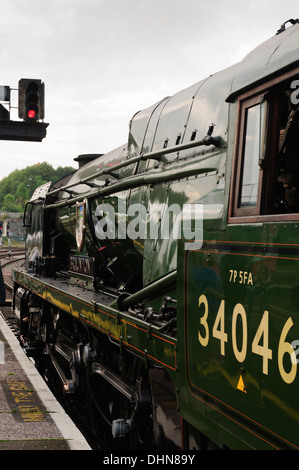 Steam train waiting at a red light - Stock Image