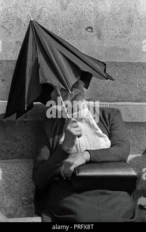 Heat wave Trafalgar Square London England UK 1976 Woman sheilds herself from the record breaking heat during the heat wave of 1976 in Trafalgar Square London. - Stock Image