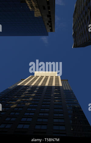 Looking up at the sky through buildings in Sydney's central business district. - Stock Image