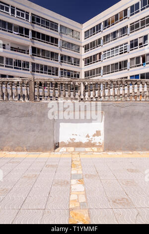 Decaying concrete balustrade and flats  at La Garita, Gran Canaria, Canary Islands - Stock Image