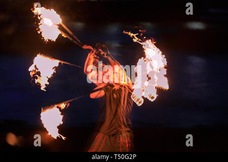 London, UK. 19th Apr, 2019. A member of the 'London Fire Spinners' group of acrobats, fire eaters, fire spinners and jugglers practices his spinning skills on the Thames River beach in London's South Bank. (in-camera multiple exposures) Credit: Imageplotter/Alamy Live News - Stock Image
