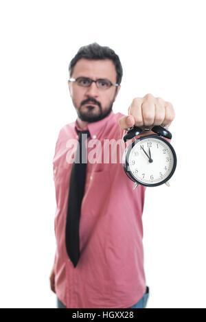 Young man showing an alarm clock - Stock Image