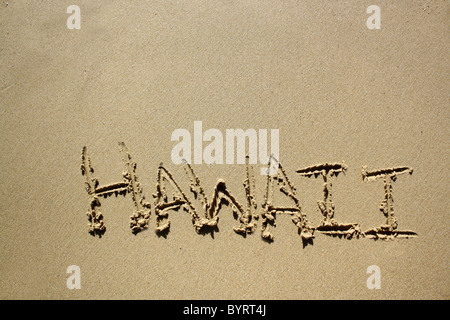 'Hawaii' written out in wet sand. Please see my collection for more similar photos. - Stock Image