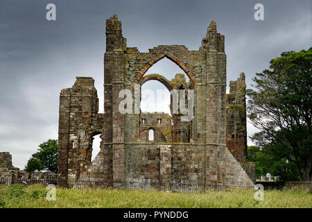 Back of Lindisfarne church ruins of the medieval priory on Holy Island of Lindisfarne Berwick-upon-Tweed England UK - Stock Image