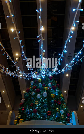 Christmas tree in a Singapore Shopping centre - Stock Image