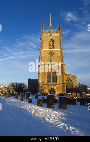 St Peter's Church, Hook Norton, Oxfordshire in the sunshine following a severe snowfall - Stock Image