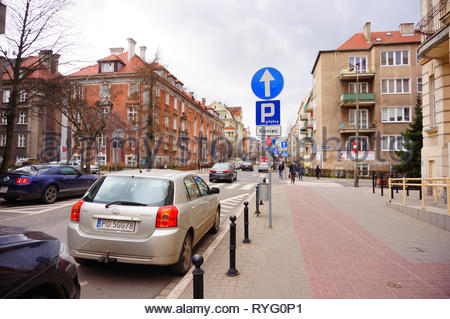 Poznan, Poland - March 8, 2019: Parked Toyota Corolla car on a parking sport by a sidewalk on the Slowackiego street in the city center. Parking spots - Stock Image
