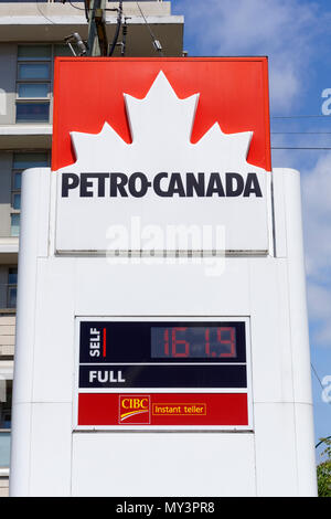Petro-Canada gas station sign showing high gas price per liter in Vancouver, BC, Canada - Stock Image