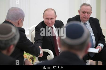Moscow, Russia. 27th Feb, 2019. Russian President Vladimir Putin shakes hands with Israeli Prime Minister Benjamin Netanyahu during a bilateral meeting at the Kremlin February 27, 2019 in Moscow, Russia. Credit: Planetpix/Alamy Live News - Stock Image