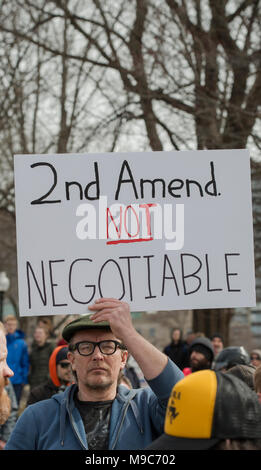 Boston, MA, USA 3-24-2018:  Less than 100 pro-gun advocates attempted to demonstrate at the edge of more than 100 thousand March For Our Lives (MFOL) anti-gun demonstrators who converged on the Boston Common, the oldest public park in the U.S.  The MFOL demonstrations were a reaction to a school shooting at Marjory Stoneman Douglas High School on Valentine's Day of 2018 in Parkland Florida.  The shooting in Florida left 17 high school students dead. Pro-gun demonstrators were surrounded by Boston Police to separate them from the MFOL demonstrators. Credit: JBCN / Alamy Live News - Stock Image