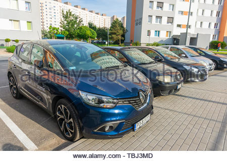 New blue parked Renault Scenic car by a sidewalk - Stock Image