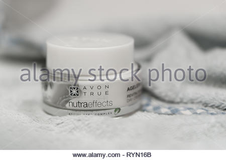 Poznan, Poland - March 8, 2019: Avon True nutraeffects aging cream in a container on a soft towel. - Stock Image