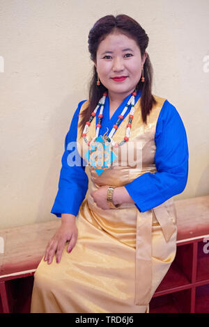 Posed portrait of a Nepalese Buddhist performer in traditional costume at the Sherpa Temple in Elmhurst, Queens, New York City. - Stock Image