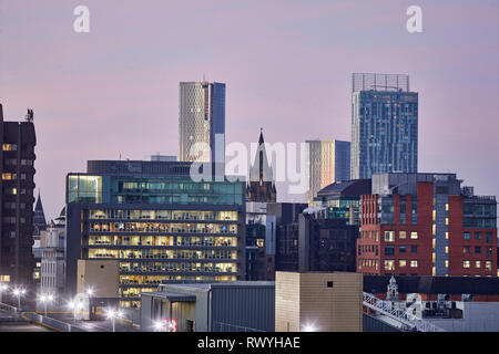 Dawn first light Manchester skyline from above looking to the Town hall and Deansgate Square - Stock Image