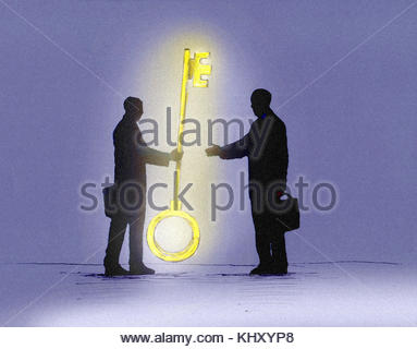 Businessman handing over large glowing gold key to colleague - Stock Image