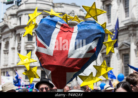 London, UK. 23 June 2018.Anti-Brexit march and rally for a People's Vote in Central London. Union Flag heart surrounded by the yellow stars of the European Union Flag. - Stock Image