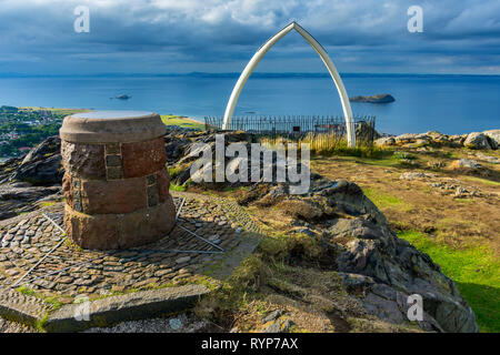 The toposcope (viewpoint indicator) and replica whale bones on the summit of North Berwick Law, East Lothian, Scotland, UK - Stock Image