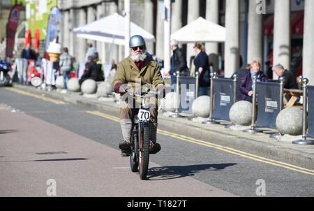 Brighton, UK. 24th March 2019. Mike Lawson on a 1910 Triumph nears the finish of the 80th Anniversary Pioneer Run for pre 2015 veteran motorcycles in Brighton . The run organised by the Sunbeam Motor Cycle Club begins on the Epsom Downs in Surrey and finishes on Madeira Drive on Brighton seafront Credit: Simon Dack/Alamy Live News - Stock Image